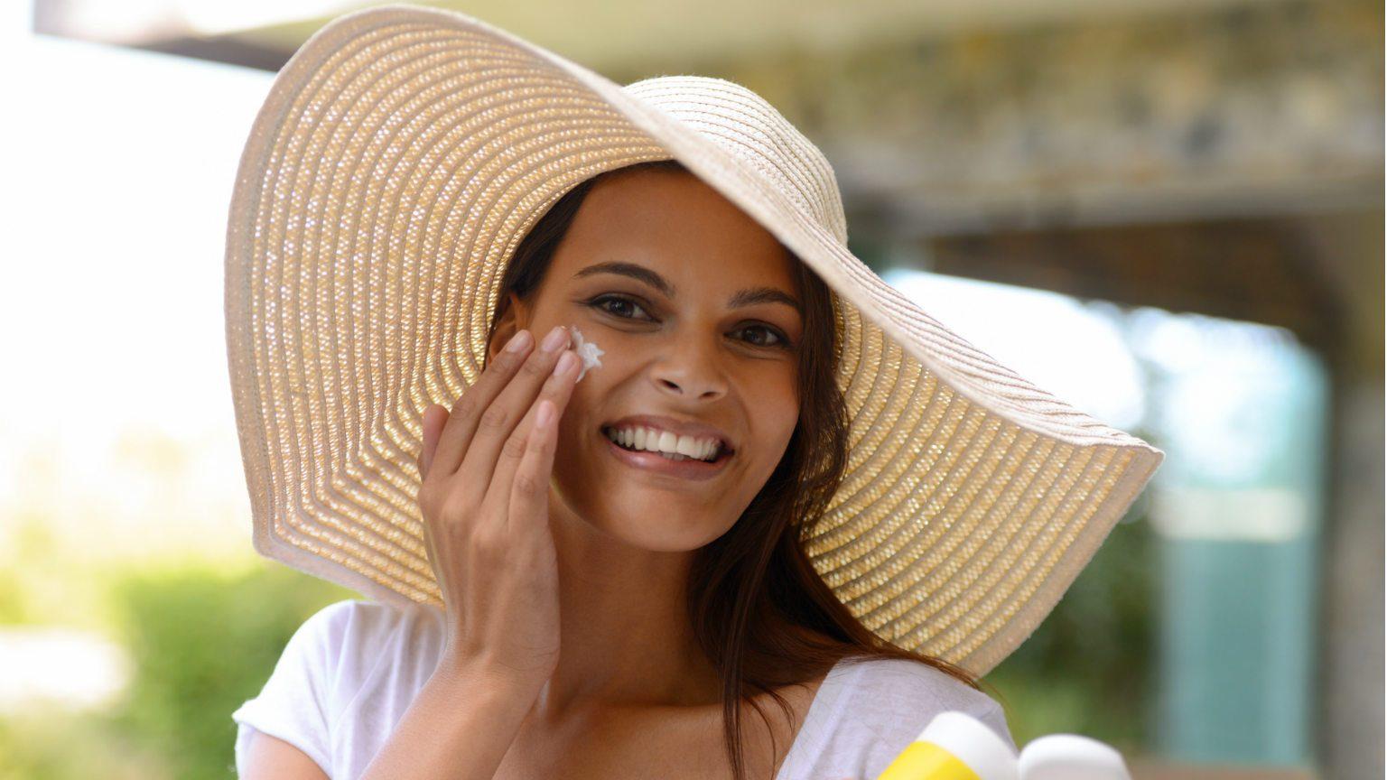 Young Woman Applying Sunscreen