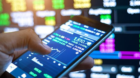 Cropped Image Of Man Checking Stock Market On Mobile Phone