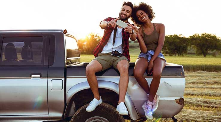 Couplesittingonacar_GettyImages_738x410