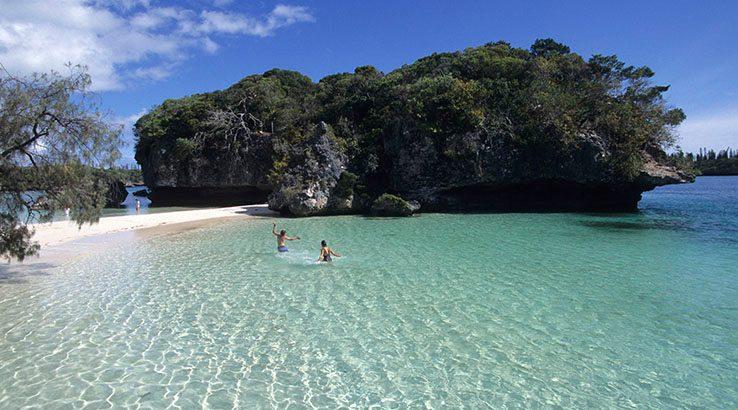 People swimming in Kanumera Bay, Isle of Pines, Kuto, New Caledonia