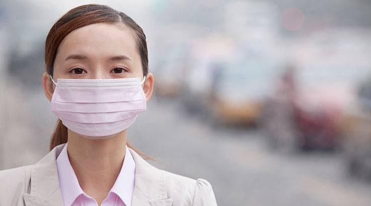young_businesswoman_wearing_face_mask_738x410_Getty_optimised