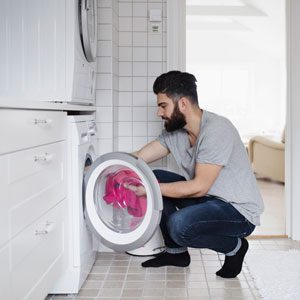 Manleaningonthedryer_GettyImage_300x300