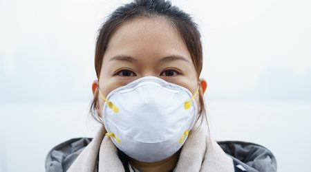 Asian woman with protective n95 face mask