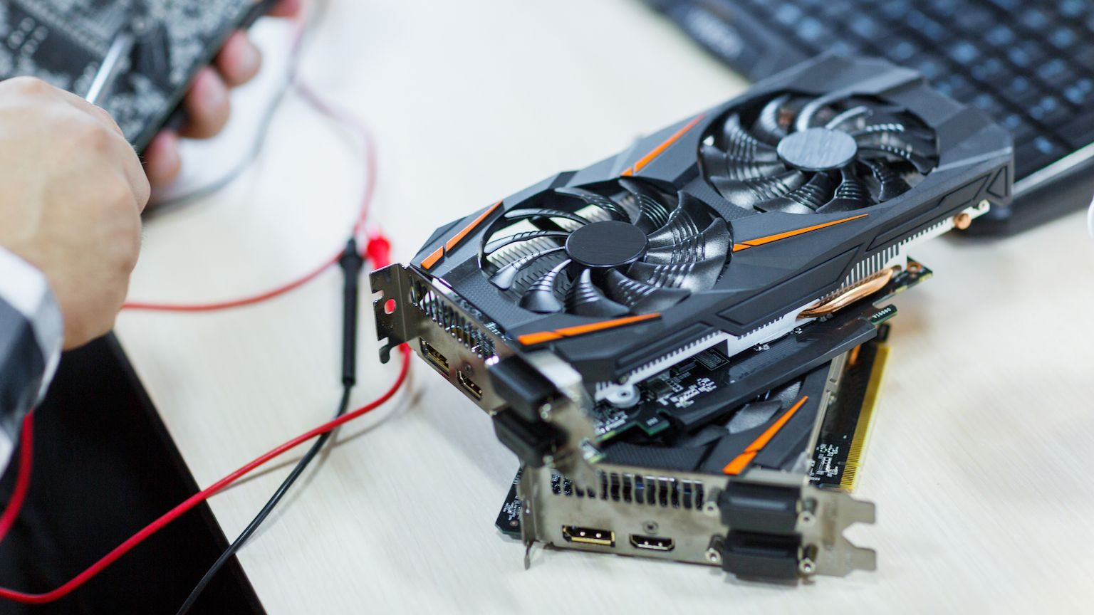 Close up of two graphics cards stacked on top of each other