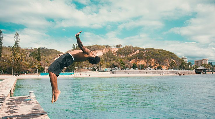 Backflip Pacific Islander jumping into the Water Noumea Beach New Caledonia