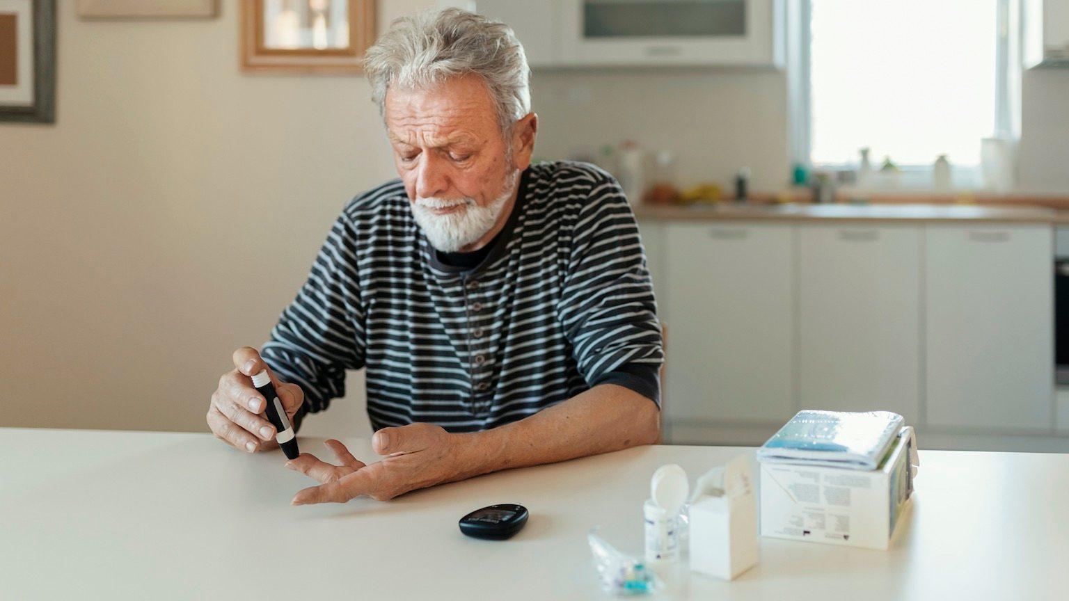Elderly man testing for high blood sugar.