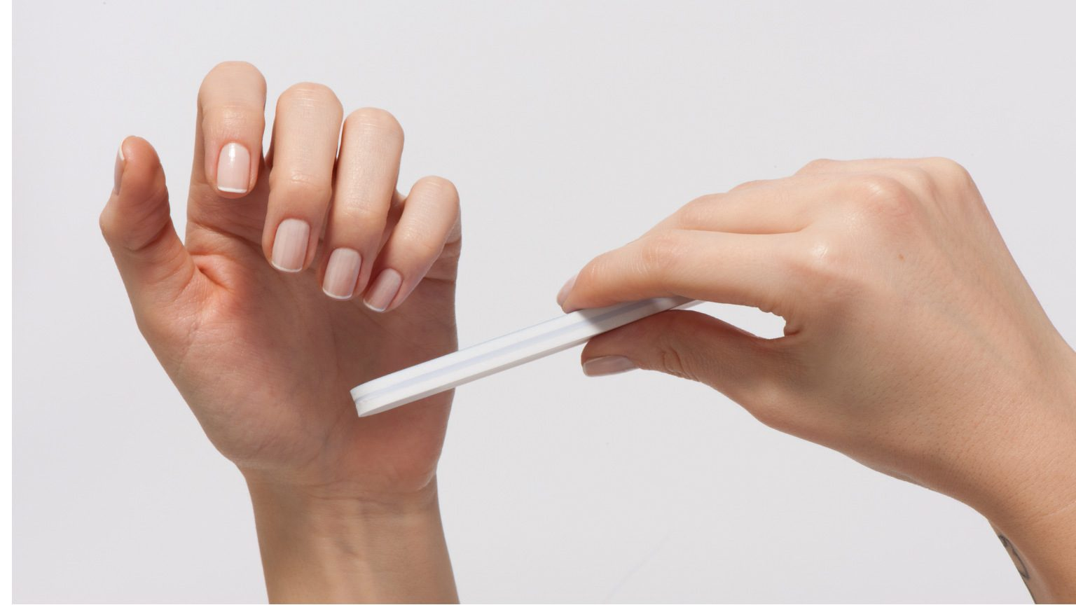 Model filing her nails