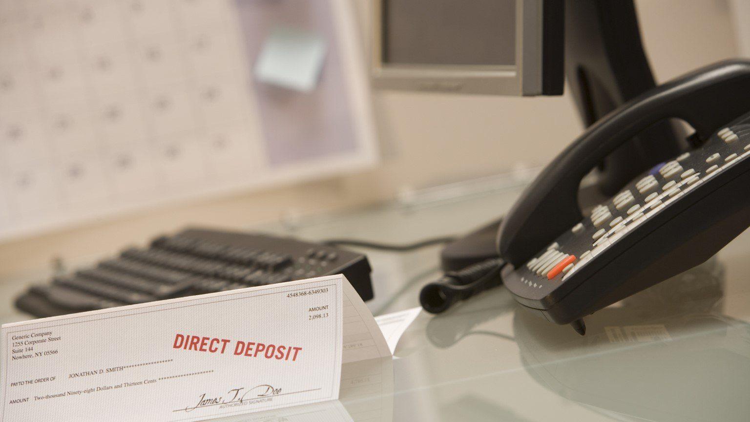 Direct deposit check on desk