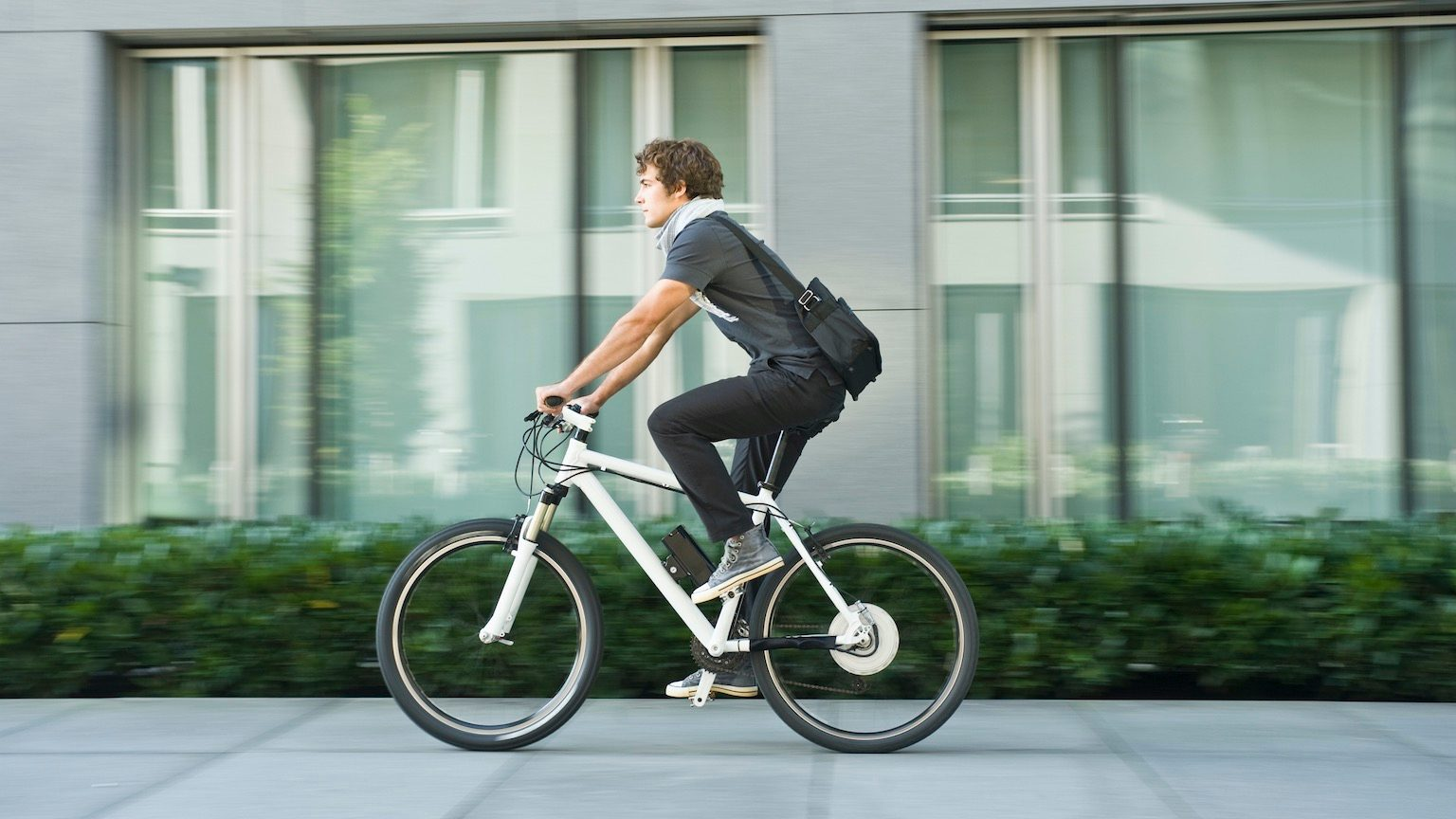 Young man riding bicycle
