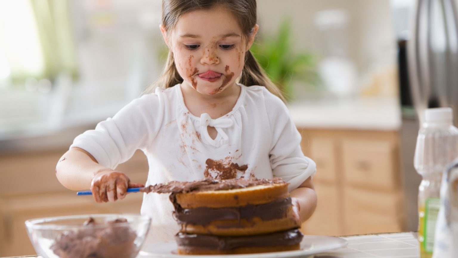 girl frosting cake