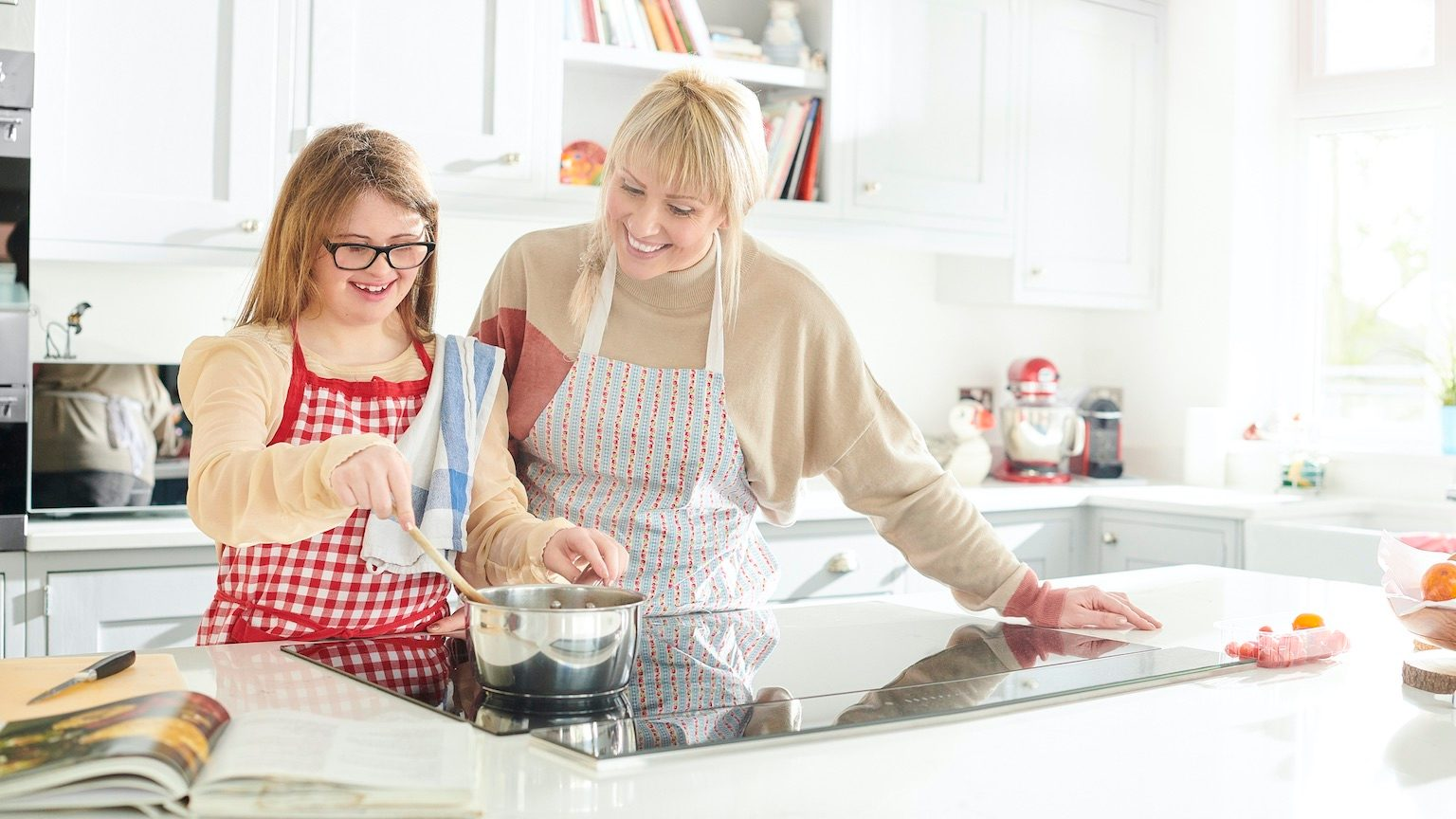 mother and daughter cooking fun