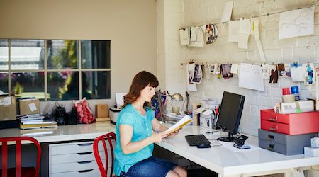 A woman works from her home office