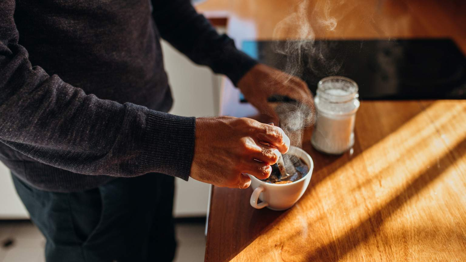 Australian man makes a cup of steaming hot coffee for himself