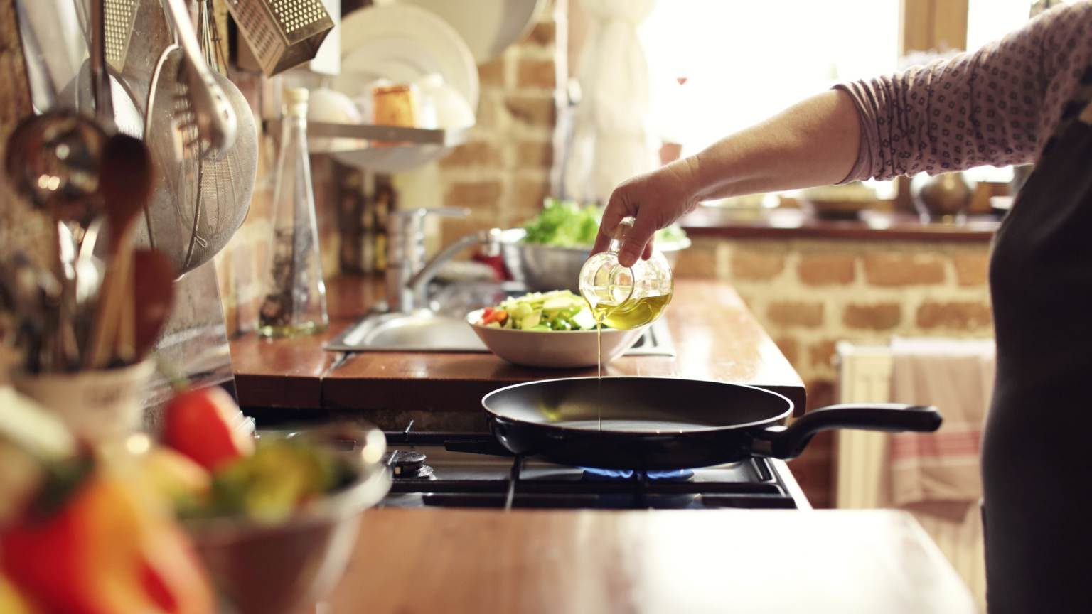 cooking vegetables in real, rustic kitchen. Natural light, short DOF, a little bit noisy.