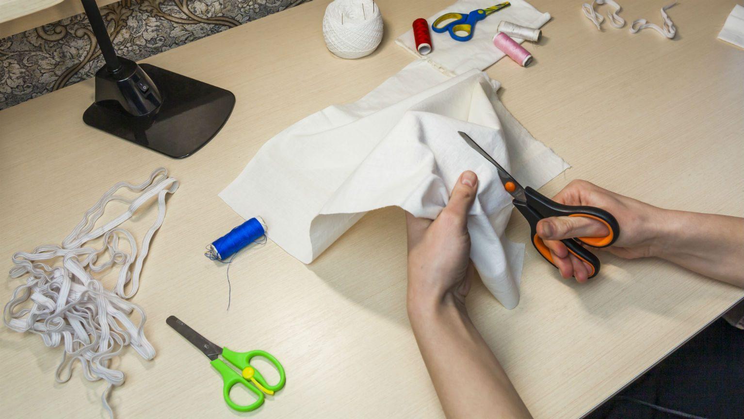 Person cutting cloth