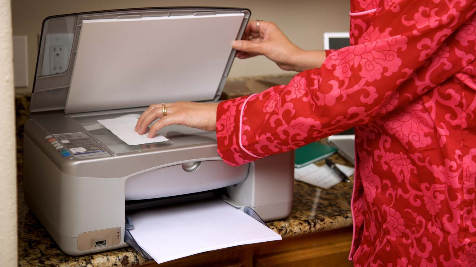 middle aged adult woman in pajamas early morning working with computer technology INSPECTOR: Shot prior to September 1 with appropriate model release/information attached)