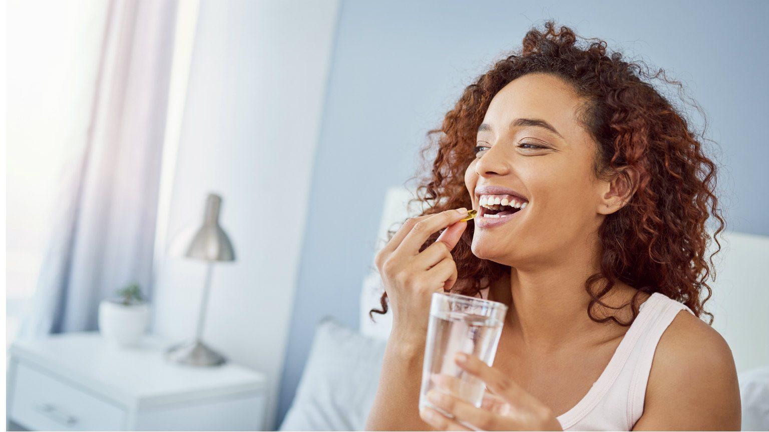 Woman taking vitamins