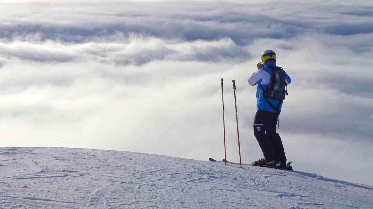 Skier taking a photo