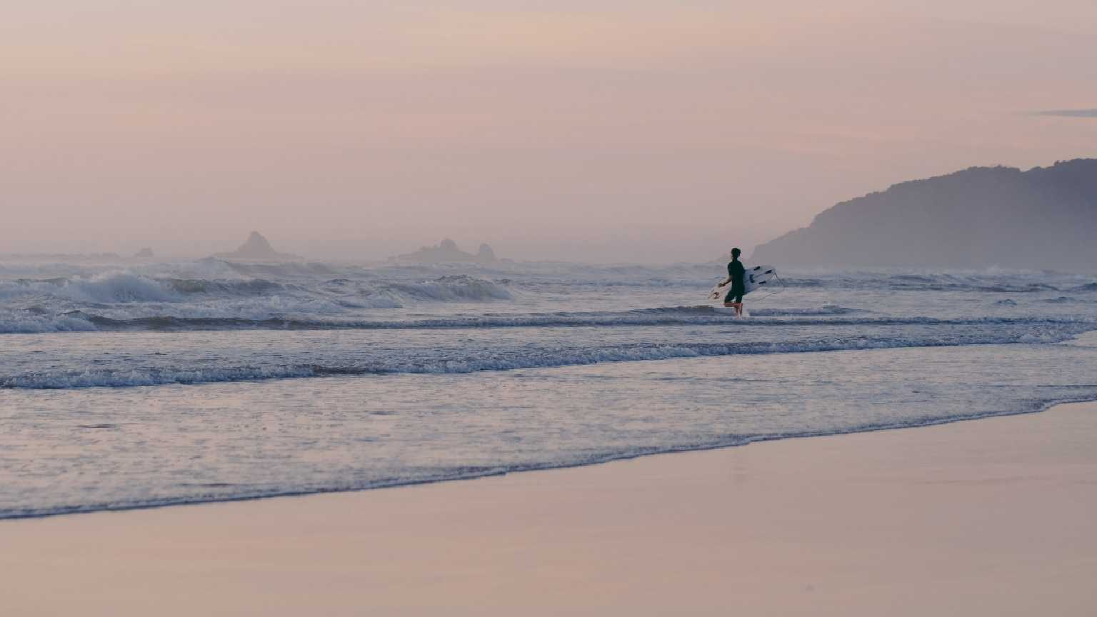 Byron Bay surfer at sunset