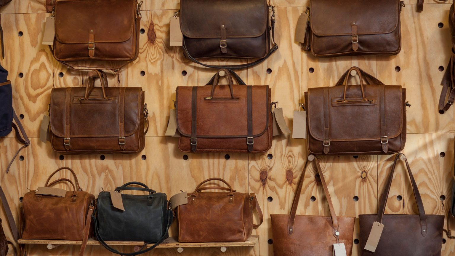 Leather bags hanging on wall