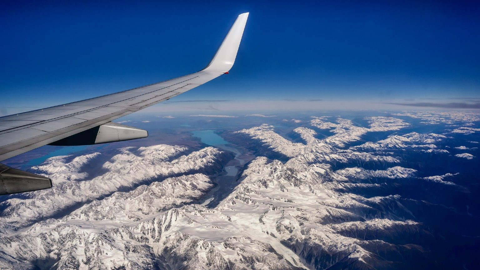 A plane flying over Christchurch's mountains.