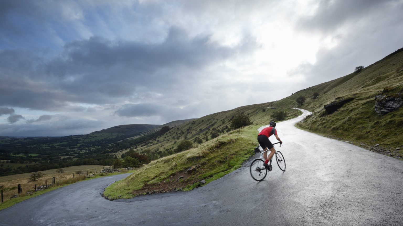 Road Cycling Climbing Hairpin Bends Up Hillside