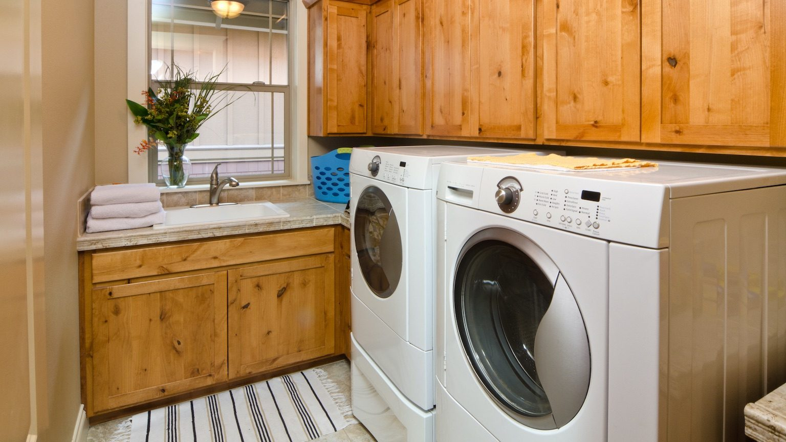 modern laundry room with front loading washing machine and dryer