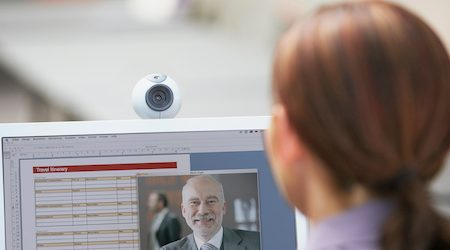 Businesspeople teleconferencing with webcam