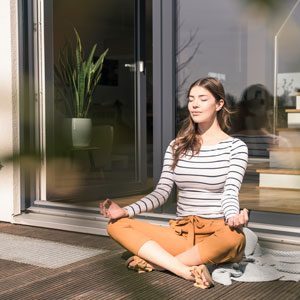 WomanPracticingYoga_Getty_300x300