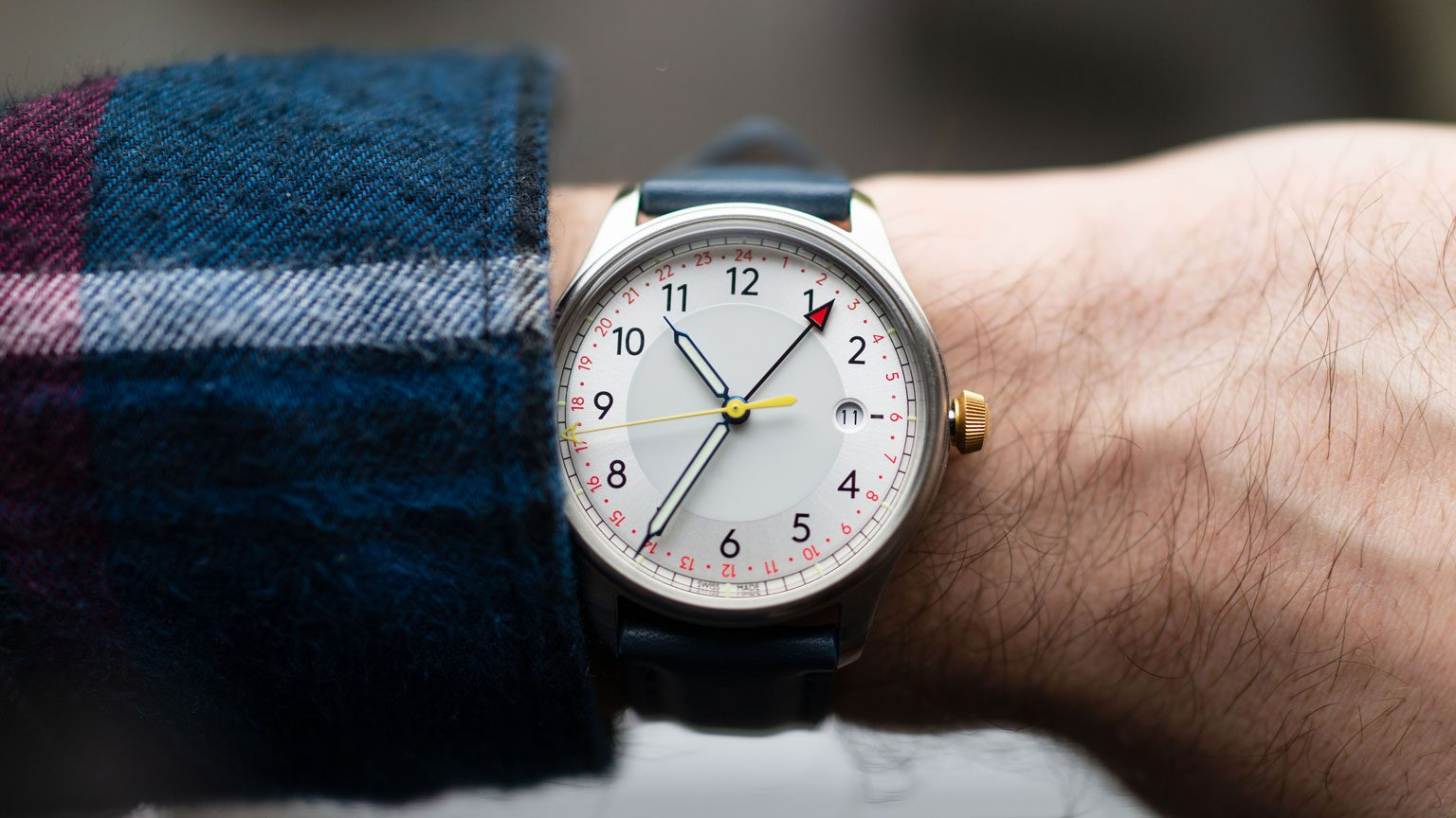 What with White Dial and leather strap