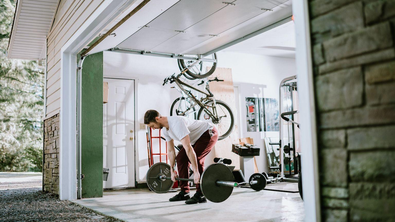 Man lifting weights at home