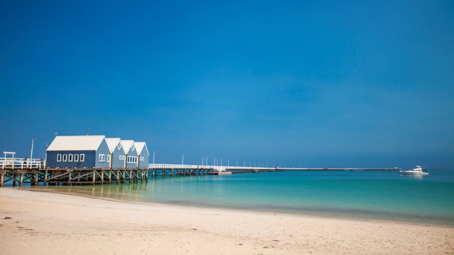 Busselton Jetty is the longest wooden jetty in the world, stretching almost 2 km out to sea from the town of Busselton, Western Australia. (Busselton Jetty is the longest wooden jetty in the world, stretching almost 2 km out to sea from the town of Bu