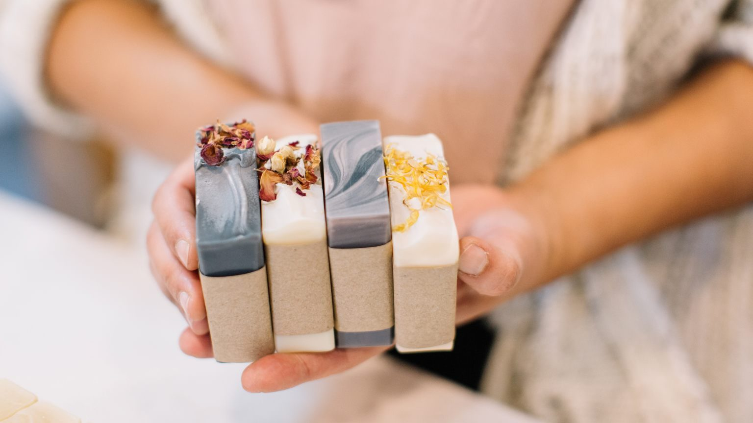 Featuring different scents and flavors of homemade bars of soap.