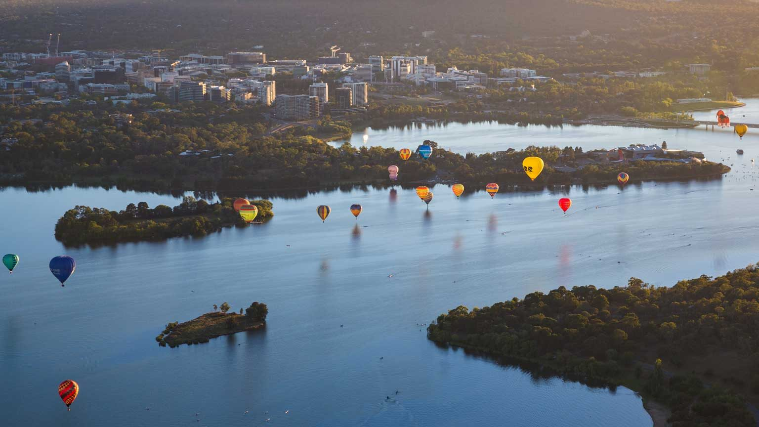 Aerial view from a Hot Air Balloon at sunrise of Lake Burley Griffin and Black Mountain Tower during the Canberra Balloon Spectacular with occurs in March every year in the Australian Capital Territory in Australia