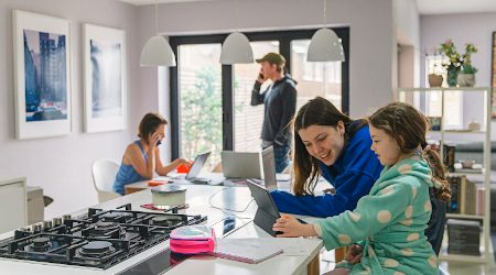 Children studying at home whilst parents work from home