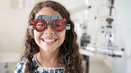 Happy_Girl_At_The_Optometrist_GettyImages_450x250