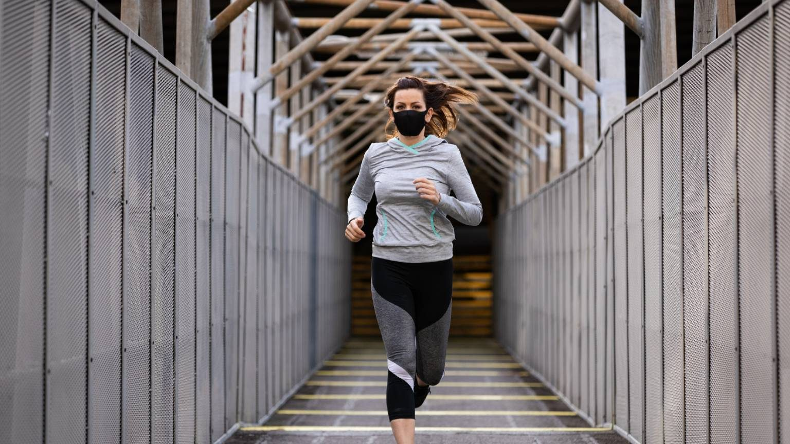 Running woman in mask