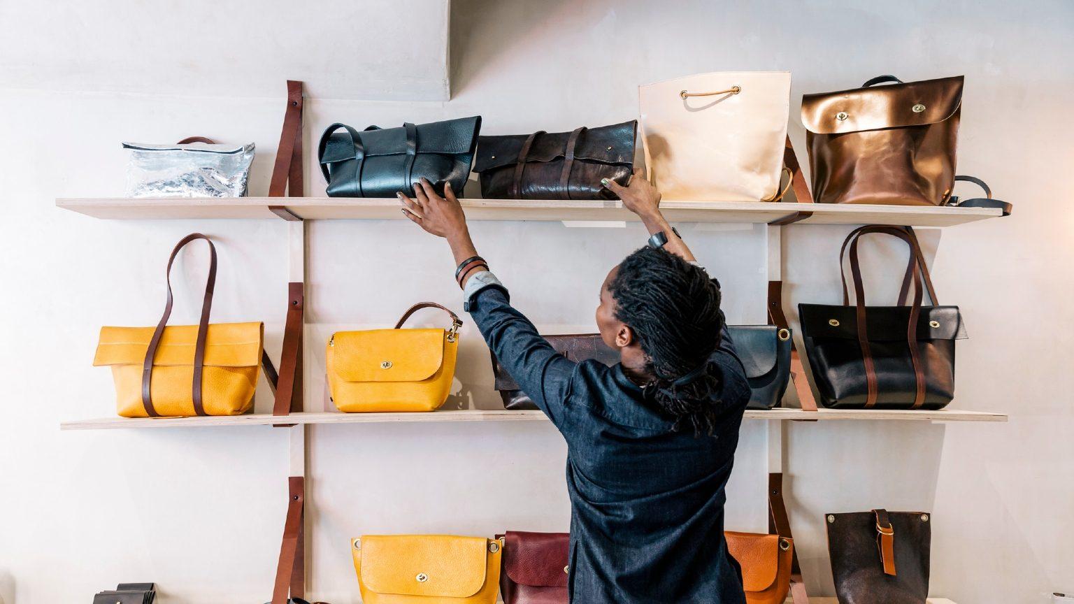 arranging handbags
