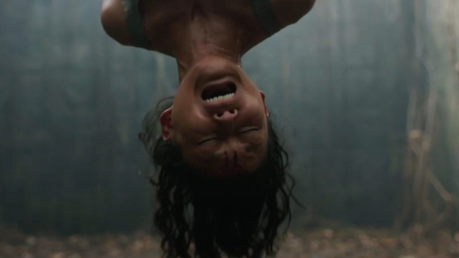 Female hanging upside down. Impetigore
