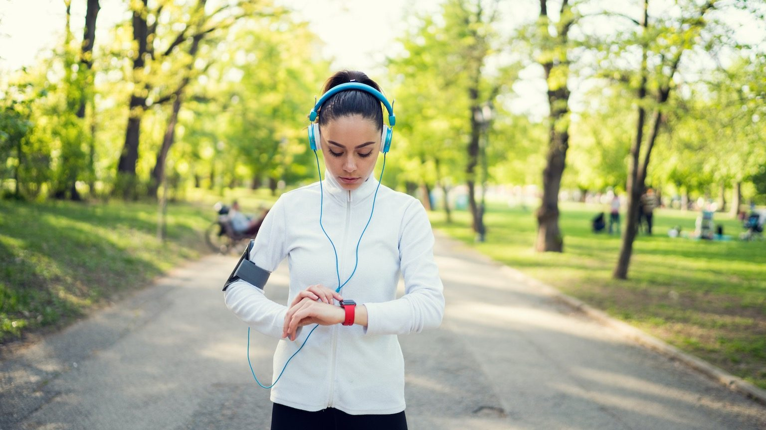 Attractive woman checking fitness tracker after sports training
