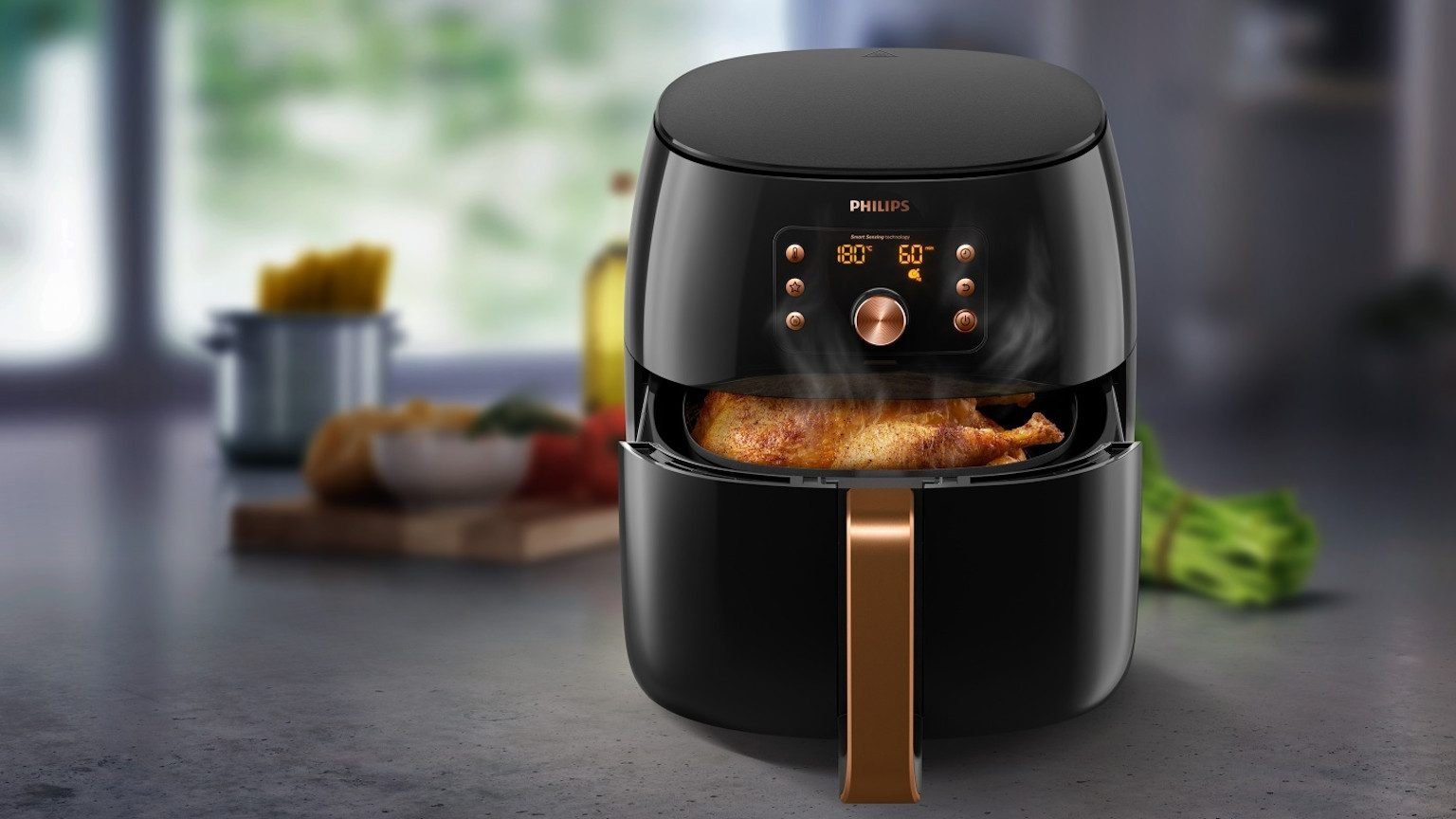 Philips air fryer on kitchen bench.
