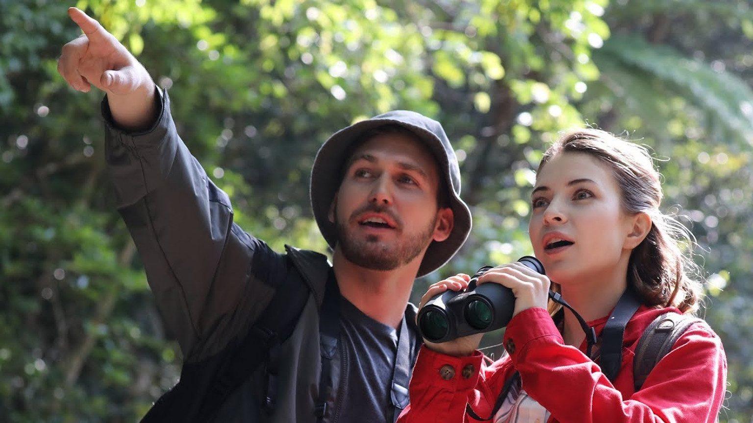 Couple using Canon binoculars