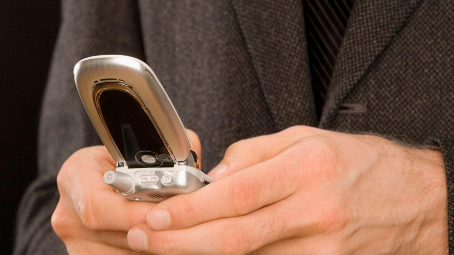 Close-up of a businessman text messaging