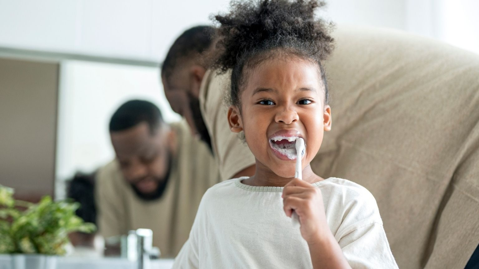 Cute-young-girl-brushing-her-teeth