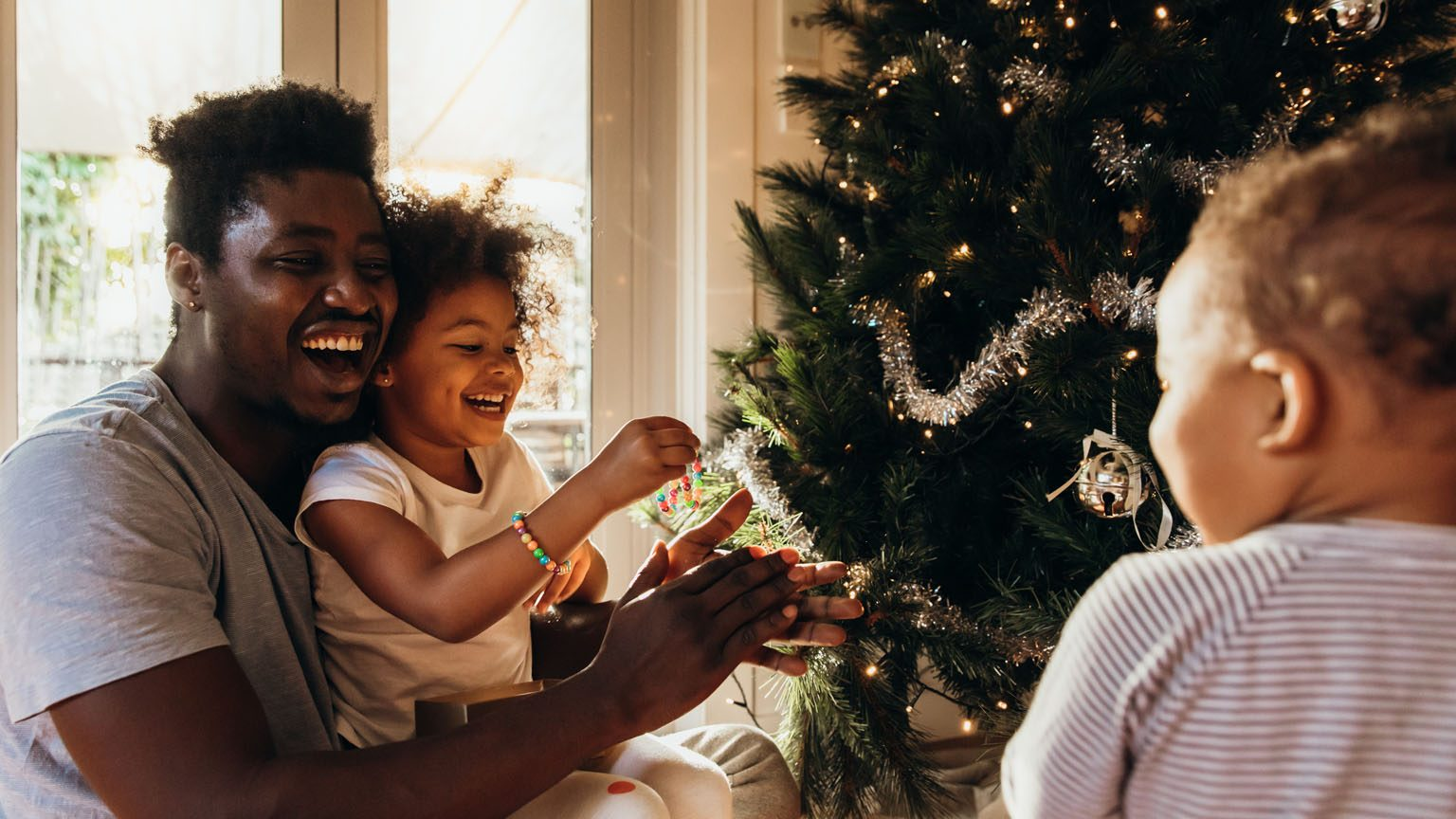Father and Kids Decorating the Christmas Tree