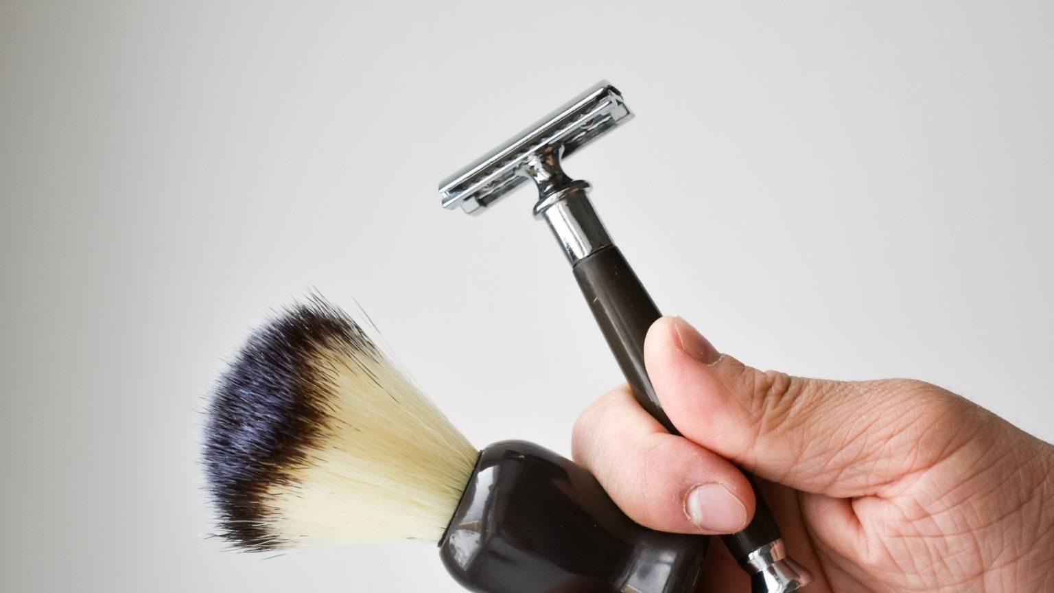 Man Holding Shaving Kit