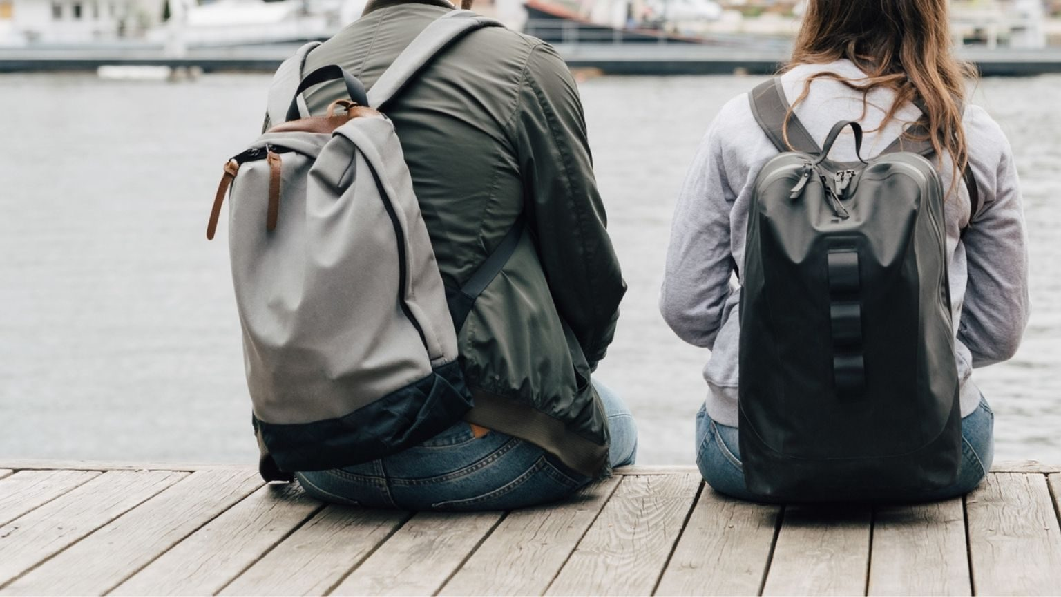 Rear view of friends with backpacks