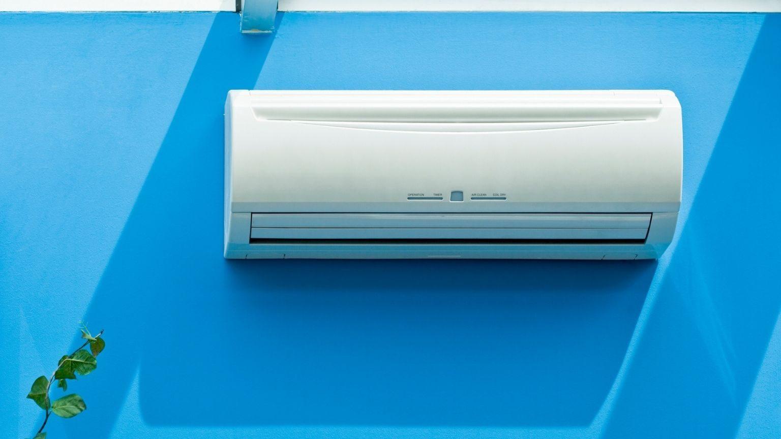Split Type Air Conditioner on blue background