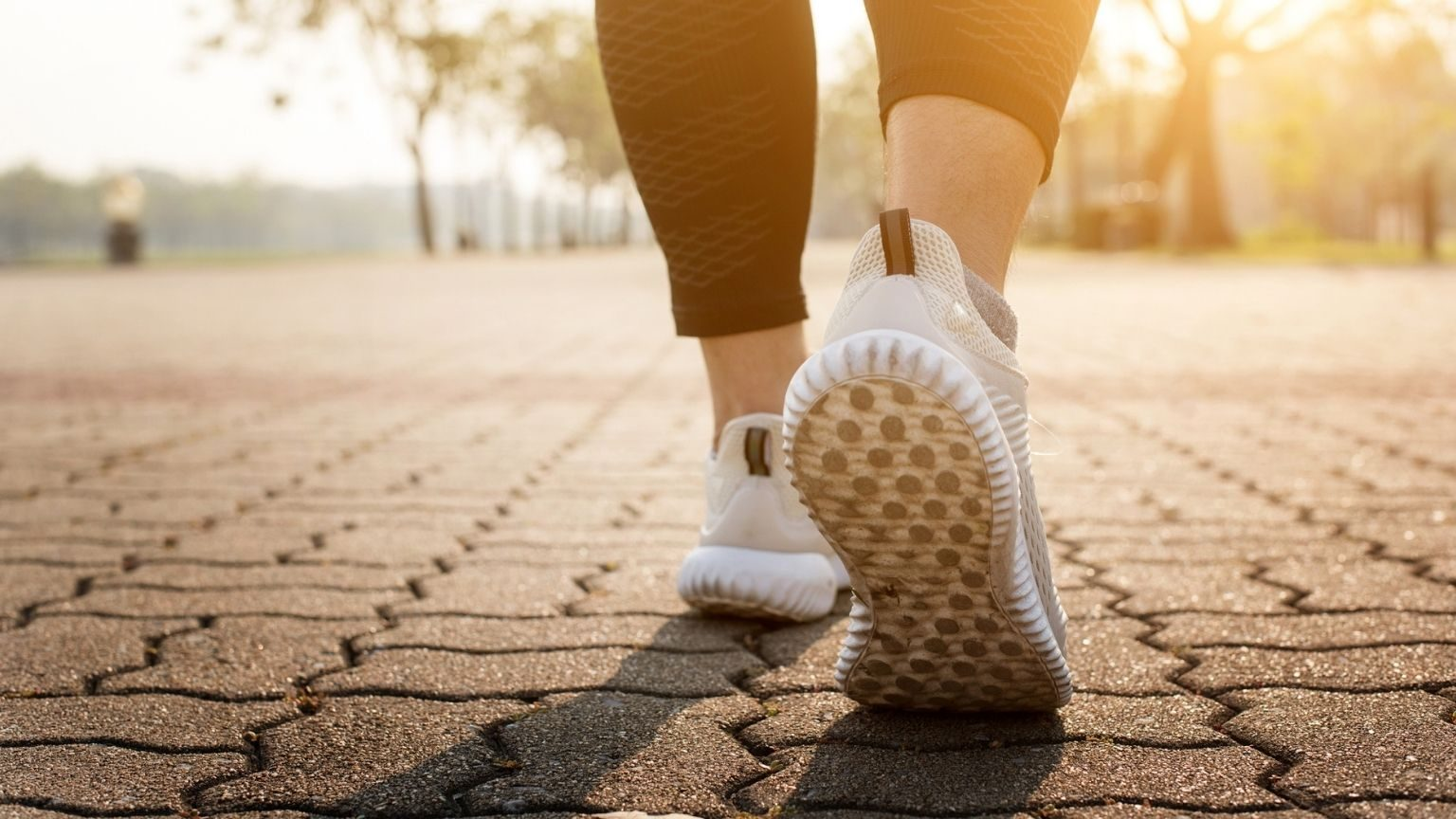 Woman walking on road closeup on shoe