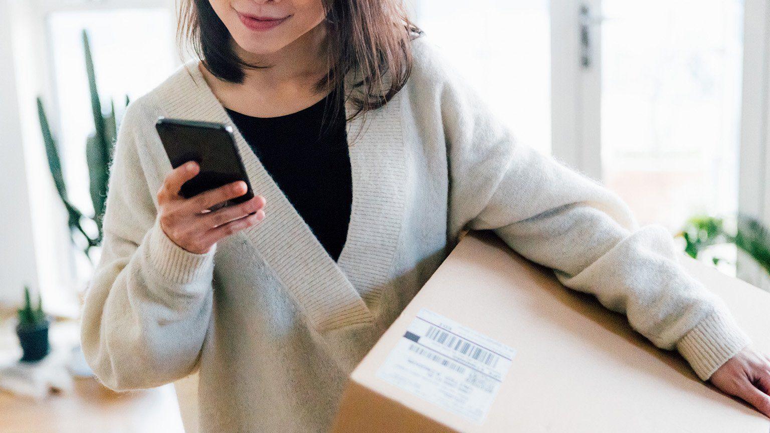 Woman smiling receiving parcel